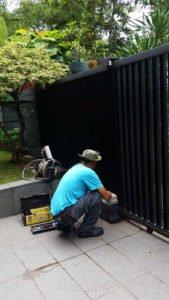 man repairing a gate